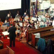 Rehearsal of Van Den Booren's La Passion de Jeanne D'Arc, Essex Symphony Orchestra